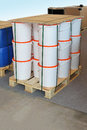 Pallet buckets packed cargo with white plastic Royalty Free Stock Photos