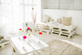 Pallet interior home behind in white pure living room Stock Photos