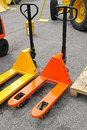 Pallet jack two pump trucks jacks for warehouse Royalty Free Stock Photo