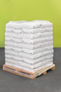 Pallet of sacks white polypropylene at transport Stock Photos