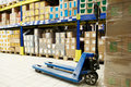 Pallet stacker truck at warehouse Royalty Free Stock Image