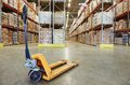 Pallet stacker truck at warehouse manual forklift equipment Royalty Free Stock Image