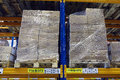 Pallets with boxes stand on a shelf goods warehouse. Royalty Free Stock Photo