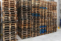 Pallets stack of used wooden in distribution warehouse Royalty Free Stock Photography
