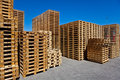 Pallets stacked symbolic photo for freight transport and logistics Stock Images