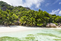 Palm trees and perfect beach la digue seychelles white anse pierrot near source d argent in with some Royalty Free Stock Photos