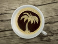 Palme in coffee cup Royalty Free Stock Photo