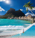 Palms hammock and ocean bora bora polynesia view of the mountain through the Royalty Free Stock Image