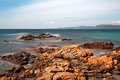Palombaggia beach corsica long exposure picture of sea water passing through rocks on the of in the south of Royalty Free Stock Photos