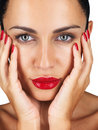 Pampering - Cute young woman touching her face Royalty Free Stock Photo
