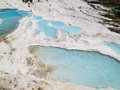Pamukkale pools blue water of white limestone Stock Photos