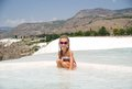 Pamukkale turkey little girl on the background of the travertine pools and terraces Stock Images