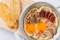 Pan fried egg with toast vietnamese style freid chinese sausage minced pork vietnamese sausage in metal on wood plate Royalty Free Stock Image