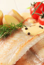 Pan fried fish fillets and potatoes Royalty Free Stock Images
