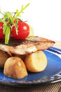 Pan fried fish with potatoes Royalty Free Stock Image