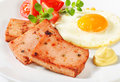 Pan fried leberkase with sunny side up fried egg meatloaf and mustard Royalty Free Stock Images