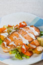 Pan fried salmon on a garden salad topped with fresh butter and hollandaise sauce Stock Images