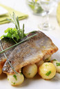 Pan fried trout with potatoes Royalty Free Stock Photos