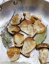 Pan-frying boletus mushrooms Royalty Free Stock Image