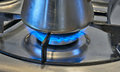Pan on a gas burner closeup shot of boiling Stock Images