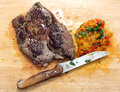 Pan seared steak and pickled peppers Stock Image