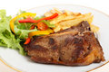 Pan-seared t-bone steak meal Stock Photography