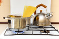 Pan with spaghetti and a kettle Royalty Free Stock Photo