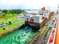 Panama Canal, Panama - December 7, 2019: A cargo ship entering the Miraflores Locks in the Panama Canal Royalty Free Stock Photo