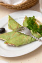 Pancake on dish green white with fork Stock Image