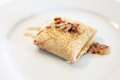 Pancake with pine nuts and butter Royalty Free Stock Photography