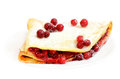 Pancake with raspberry jam and cowberry berries Royalty Free Stock Photography