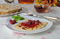 Pancake with raspberry jam pancakes and berries Royalty Free Stock Images
