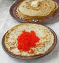 Pancake with red caviar Stock Images