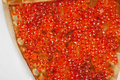 Pancake with red caviar closeup photo Stock Photos