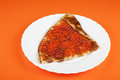 Pancake with red caviar on orange background Stock Images