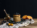Pancake tower with fresh blueberries, oranges and mint on a rustic metal plate. Royalty Free Stock Photo