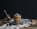 Pancake tower with fresh blueberry and mint on a rustic metal plate. Royalty Free Stock Photo