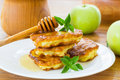 Pancakes with apples and honey sweet on a plate Stock Photography