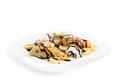 Pancakes with banana slices, ice cream and chocolate isolated on white Royalty Free Stock Photo