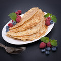 Pancakes with berries on a dish Royalty Free Stock Image