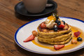 Pancakes with berries and maple syrup closeup of Royalty Free Stock Photo