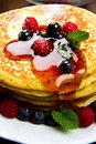Pancakes with berries and maple syrup some Stock Photos