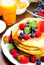 Pancakes with berries and maple syrup some Stock Image