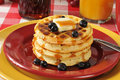 Pancakes with blueberries a stack of hotcakes maple syrup and fresh Royalty Free Stock Image
