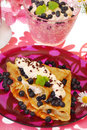 Pancakes with blueberry and whipped cream Stock Photos