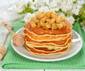 Pancakes with caramelized apples on a white table Stock Image