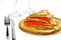 Pancakes with caviar plate of a knife and fork on a white background Stock Photos