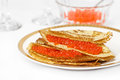 Pancakes with caviar red and on a large white plate Stock Photography