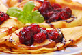 Pancakes with cherry confiture Stock Images
