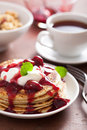 Pancakes with cherry jam and cream for breakfast Royalty Free Stock Photos